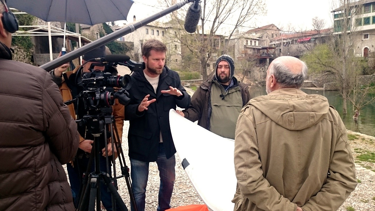Tim Slade interviews Professor Hamidovic in front of the Mostar Bridge, Bosnia & Herzegovina.