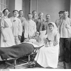 Nurses and patient at the Auxiliary Hospital Unit in Belgium. Image: Australian War Memorial.