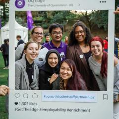 Students and staff posing in instagram frame