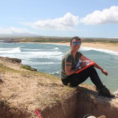 Georgie Wye recording the stratigraphic information for one of the excavation pits.