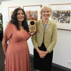 Dr Marianne Hanson and UQ Vice-Chancellor and President Professor Deborah Terry with the Nobel Peace Prize medal.